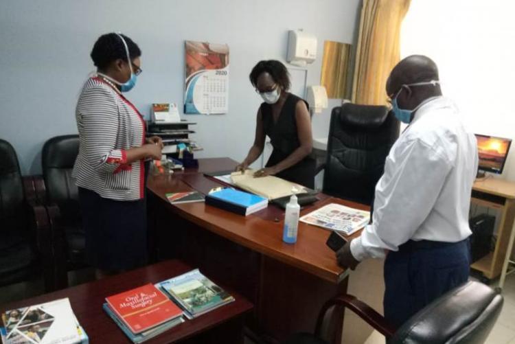 Far left Incoming CMO DR. Muhia,  Outgoing CMO DR Asimba and Admin Mr. Kinyanki